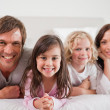 Stock Photo: Family lying in bed