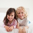 Portrait of siblings lying on their bellies — Stock Photo