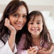 Mother and her daughter lying on a bed — Stock Photo #11210939