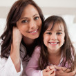 Portrait of a mother and her daughter lying on a bed — Stock Photo #11210942