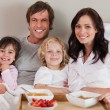 Happy family having breakfast together — Stock Photo #11210954