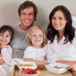 Stock Photo: Happy family having breakfast together