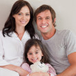 Royalty-Free Stock Photo: Parents posing with their daughter