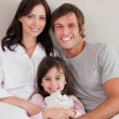 Portrait of parents posing with their daughter — Stock Photo