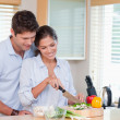 图库照片: Happy couple cooking