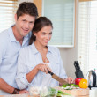 图库照片: Married couple cooking