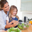 Mother and her daughter preparing a salad — Stock Photo
