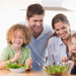 Happy family preparing a salad together — Stock Photo #11211188