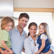 Smiling family standing up — Stock Photo