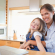 Stock Photo: Happy mother and her daughter using a laptop