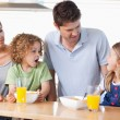 Family having breakfast — Stock Photo #11211241