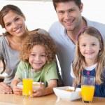 Happy family having breakfast — Stock Photo #11211246