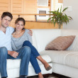 Stock Photo: Couple sitting on a couch