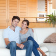 Portrait of a couple sitting on a couch — Stock Photo