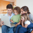 Portrait of a family using a notebook — Stock Photo