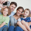 Family taking a photo of themselves — Stock Photo