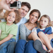 Portrait of a family taking a photo of themselves — Stock Photo