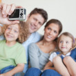 Happy family taking a photo of themselves — Stock Photo