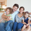 Happy family watching TV together — Foto de Stock
