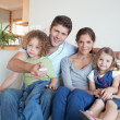 Portrait of a family watching TV together — Stock Photo #11211294