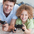 Happy boy and his father playing video games — Stock Photo