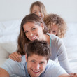 Portrait of a happy family lying on each other — Stock Photo