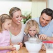 Family preparing dough — Stock Photo
