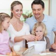 Family preparing dough together — Stock Photo #11211537