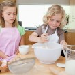 Stock Photo: Young siblings preparing dough
