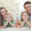 Stock Photo: Family lying on floor