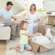 Stock Photo: Family unpacking cardboard box