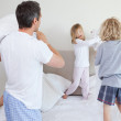Playful family having a pillow fight — Stock Photo