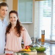 Couple standing behind kitchen counter — ストック写真