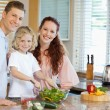 Family preparing salad — Stock Photo #11211811