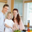 Young family preparing salad — Stock Photo #11211814