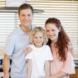 Stock Photo: Family standing together in the kitchen