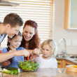 Family preparing salad together — Stock Photo #11211842