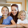 Mother with her children in the kitchen — Stock Photo
