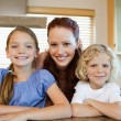 Stock Photo: Mother with her children in the kitchen