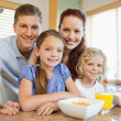 Family with breakfast in the kitchen — Stock Photo