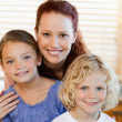Mother with children and cereals in the kitchen — Stock Photo