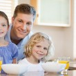 Father with his children in the kitchen — Stock Photo