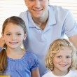 Father with his children and cereals — Stock Photo