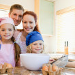 Stock Photo: Cheerful family preparing dough