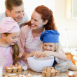 Happy family enjoys baking together — Stock Photo