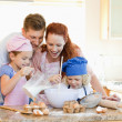 Family having a great time baking together — Стоковое фото