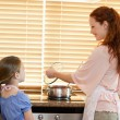 Mother and daughter preparing meal — Stock Photo