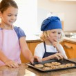 Stock Photo: Siblings stealing cookies