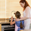 Stock Photo: Mother and daughter preparing a meal
