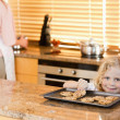 Boy stealing a cookie while his mother is not watching — Stock Photo #11211930